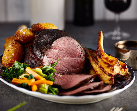 Roast Haunch of Venison, Honey Roast Parsnips, Hasselback Potatoes, Greens & Port Wine Jus
